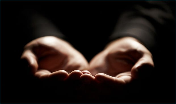 Hands held open to display receptiveness to God